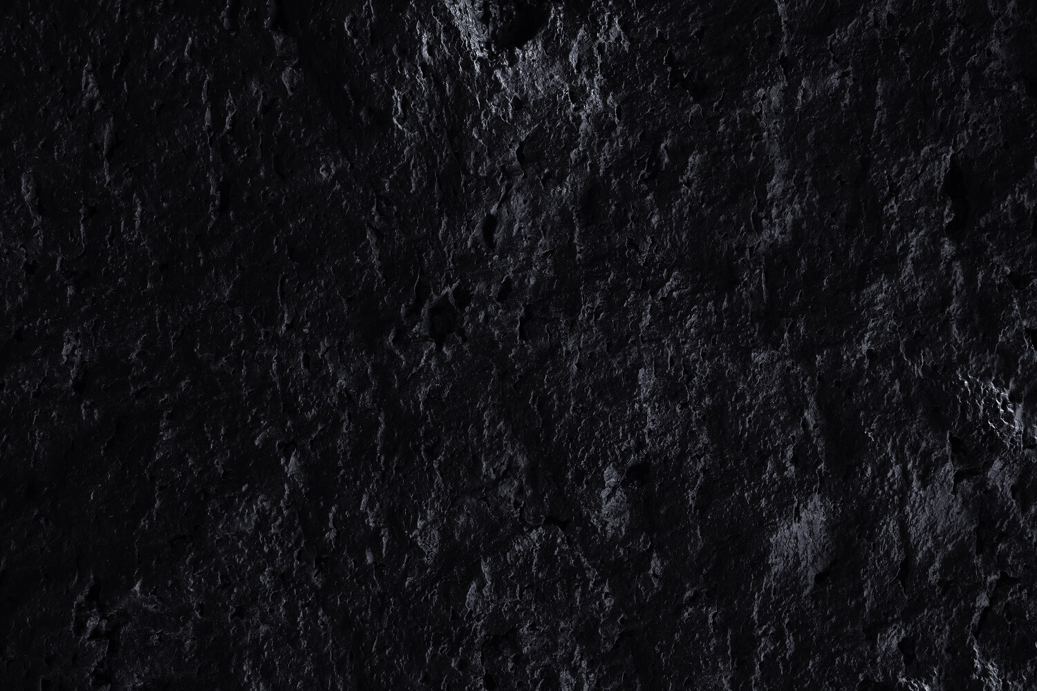 Black and rough rock surface