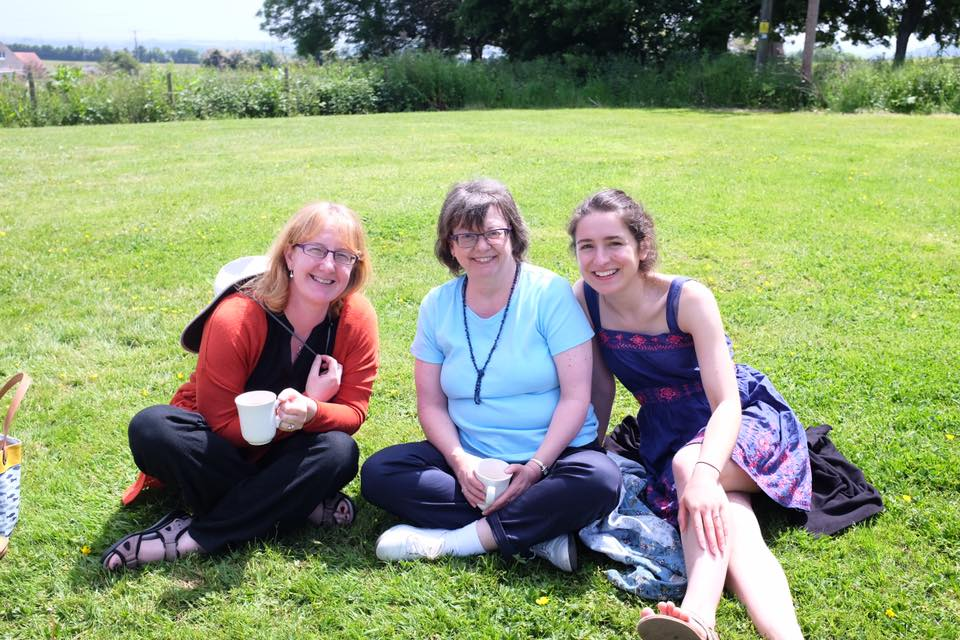 Three women seated on nice lawn